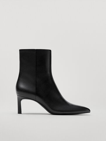 Bottines noires en cuir à bout pointu et talon
