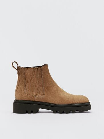 Tan leather ankle boots with elastic detail