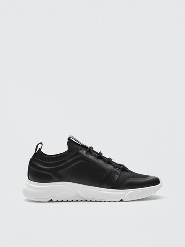 Black leather trainers with sock detail