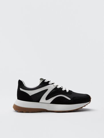 Contrast black leather trainers