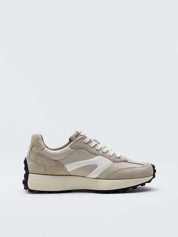 Zandkleurige leren sneakers met contrast