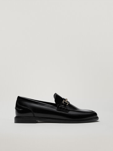 Black leather loafers with saddle strap