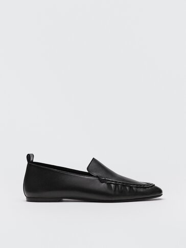 Black leather loafers with gathered detail