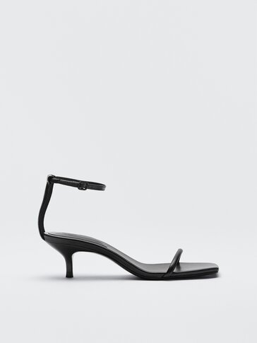 Black leather heeled sandals