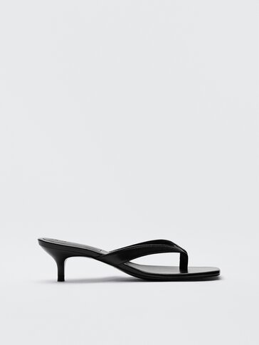 Black leather sandals with a V-shaped upper