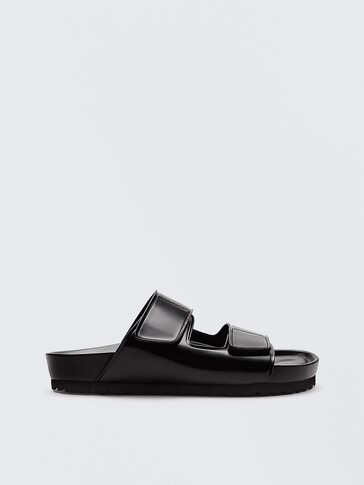 Flat leather wide-strap sandals with a glossy finish