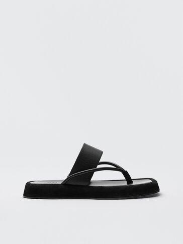 Черные сандалии из кожи на толстой подошве
