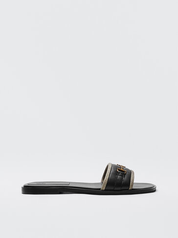 BLACK SLIDE SANDALS WITH BUCKLE AND TRIM