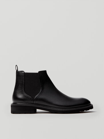 Black leather ankle boots with elastic detail