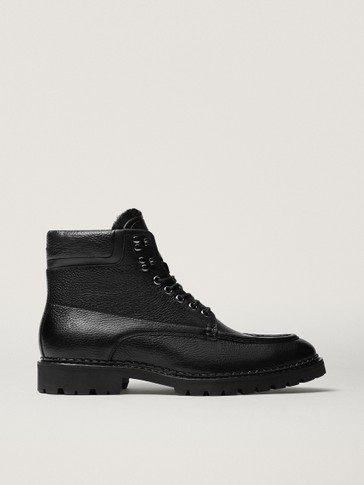 Black leather track-sole boots