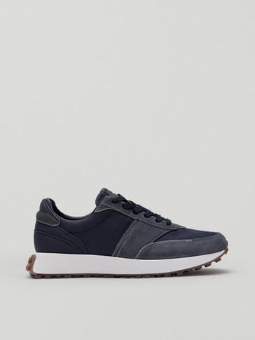 Blue leather trainers with trims