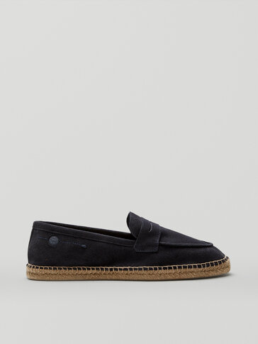 Blue leather loafers with penny strap detail