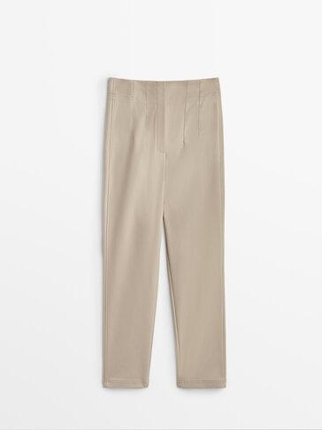 מכנסיים Skinny טכניים עם קפלים