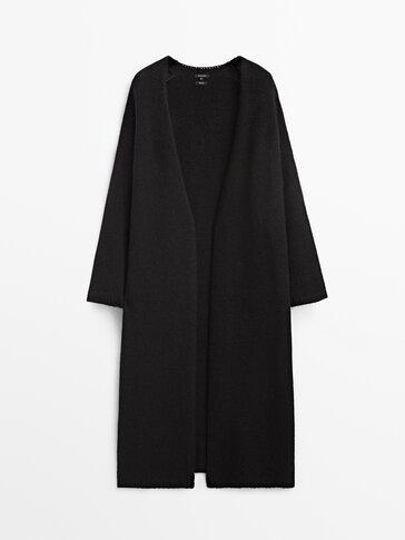 Long black knit coat